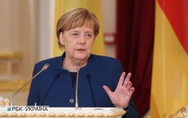 Меркель требует от РФ дальнейших шагов для снятия санкций